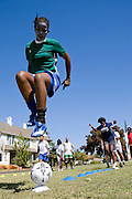 "A painted faced girl shows off her football skills in Cape town, South Africa, where the charity ""Coaching for Hope"" are working with children. Both Hope Powell and DJ Fatboy Slim work with the charity, whose innovative programme uses football to create better futures for young people in West and Southern Africa."