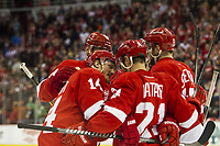 March 23, 2014: Detroit Red Wings forward Gustav Nyquist, of Sweden, (14) celebrates with teammates forward Tomas Tatar, of Slovakia, (21) and forward Riley Sheahan (15) after Nyquist scored his second goal of the game during a regular season NHL Eishockey Herren USA hockey game between the Minnesota Wild and the Detroit Red Wings played at Joe Louis Arena in Detroit, Michigan. NHL Eishockey Herren USA MAR 23 Wild at Red Wings <br /> <br /> Norway only