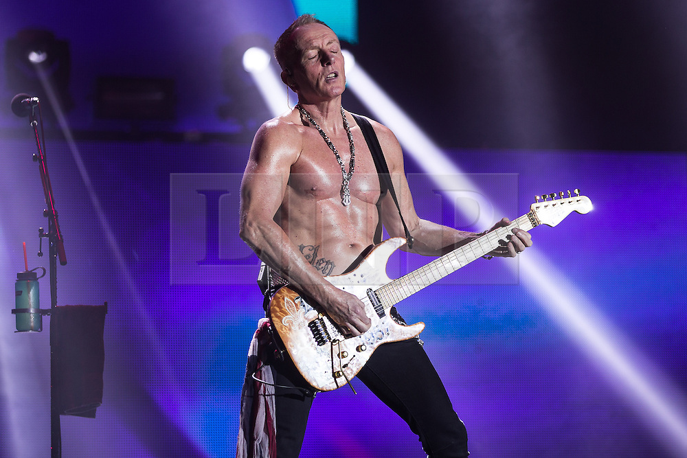 © Licensed to London News Pictures . 15/12/2015 . Manchester , UK . PHIL COLLEN . Def Leppard perform at the Manchester Arena . Photo credit : LNP