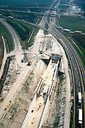 Nederland, Brabant, Knooppunt Galder, 04-04-2002; l Rijksweg A16 (in Z richting, Hazeldonk - Belgische grens) is tijdelijk verlegd ivm aanleg verdiepte kruising van de HSL (de betonnen bak id voorgrond); in Nederland loopt de HSL Oostelijke van de A16, maar omdat in Belgie dit Westelijke is, moet voor de grens de A16 gekruisd worden;infrastructuur verkeer en vervoer spoor bouw.<br /> luchtfoto (toeslag), aerial photo (additional fee)<br /> photo/foto Siebe Swart