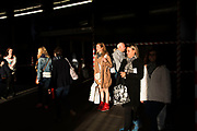 People exit a tube station in Autumn evening light, creating a great contrast between light and shadow, dark and bright. London, UK.