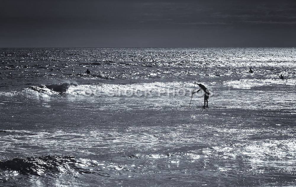 Black And White Photo Of A Stand Up Paddler
