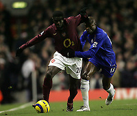 Photo: Lee Earle.<br /> Arsenal v Chelsea. The Barclays Premiership. 18/12/2005. Arsenal's Kolo Toure (L) battles with William Gallas.