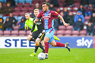 Clayton Lewis of Scunthorpe United (15) in action during the EFL Sky Bet League 1 match between Scunthorpe United and Bradford City at Glanford Park, Scunthorpe, England on 27 April 2019.