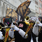 VENICE, ITALY - FEBRUARY 11:  People wearing costumes take part in the traditional parade for the Festa delle Marie in St Mark's Square on February 11, 2012 in Venice, Italy.The annual festival, which lasts nearly three weeks, will see the streets and canals of Venice filled with people wearing highly-decorative and imaginative carnival costumes and masks.