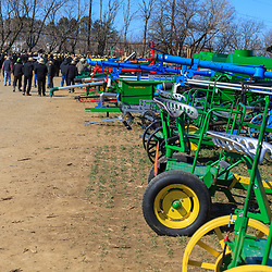 Gordonville, PA, USA - March 10, 2012: Farm equipment being sold at a public mud sale to benefit the Gordonville Volunteer Fire Company in Lancaster County, PA.