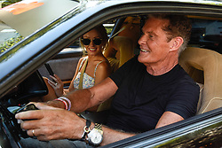 © Licensed to London News Pictures. 05/08/2018. LONDON, UK. David Hasselhoff, actor, and wife Hayley Roberts in their KITT Knightrider car, set off from the start.  Gumball 3000, a charity rally for supercars and more, including celebrity entrants, begins in Covent Garden with 150 participants beginning their journey from London to Tokyo.  Photo credit: Stephen Chung/LNP