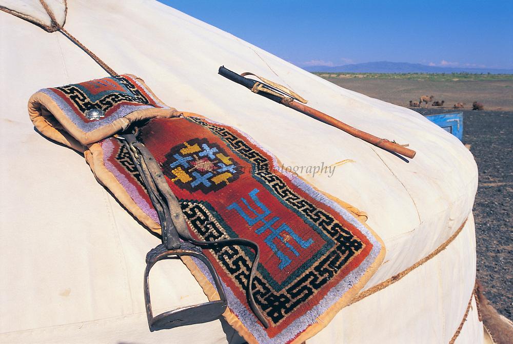 Camel saddle on ger<br /> Gobi Desert<br /> Mongolia