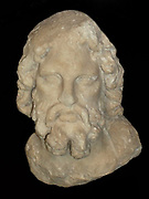 Marble head of Asclepius.  About 200-160 BC.  Found on Kos.  This head comes from a small statue of the healing god, showing him as semi-draped, like the full-length figures displayed alongside.