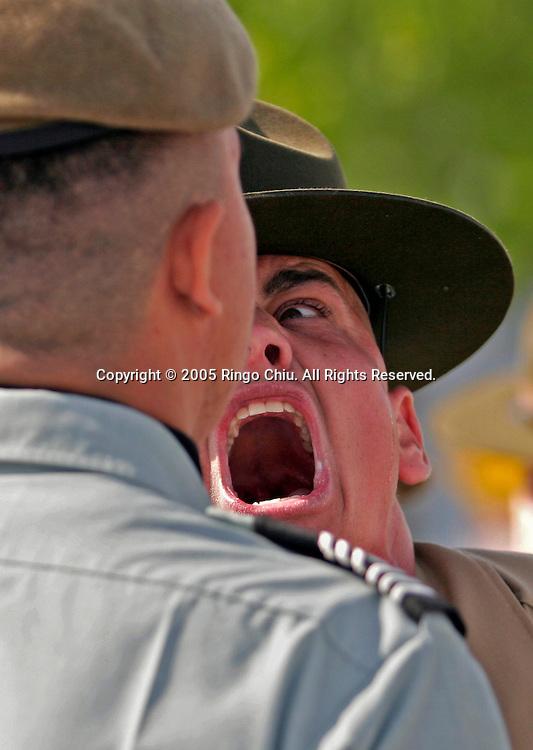 Staff Sgt. Robert S. Britt yells at Magnolia High School's cadet Marin Sebastian, 17, during the seventh annual West Coast National Junior Reserve Officers Training Corps Drill Competition in El Segundo (Photo by Ringo Chiu / PHOTOFORMULA.com).