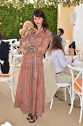 CAROLINE SIEBER and her dog Swifty at the Veuve Clicquot Gold Cup Final at Cowdray Park Polo Club, Midhurst, West Sussex on 20th July 2014.