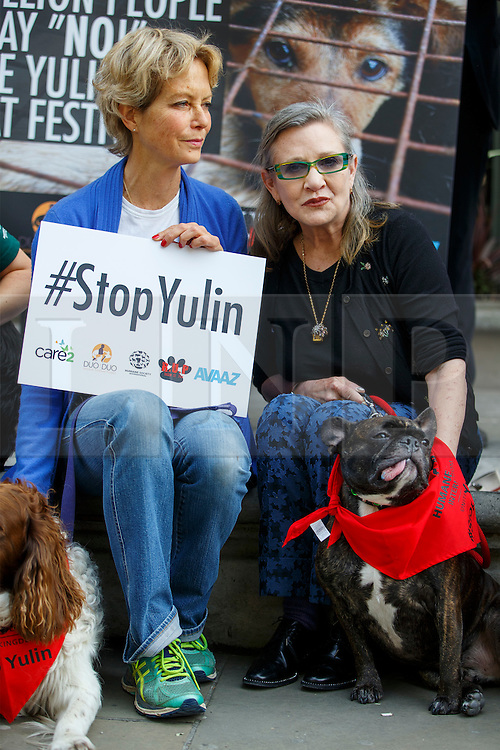 © Licensed to London News Pictures. 07/06/2016. London, UK. JENNY SEAGROVE and Star Wars actress CARRIE FISHER protest against China's Yulin dog meat festival and support handing in an 11 million-signature petition against the festival, outside Chinese Embassy in London on Tuesday, 7 June 2016. Photo credit: Tolga Akmen/LNP