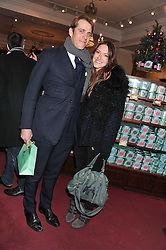 BEN & MARY CLARE ELLIOT at the Fayre of St. James Christmas Carol Service organised by the Quintessentially Foundation in aid of War Child held St.James's Piccadilly, London on 29th November 2012.