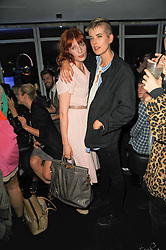 Left to right, FLORENCE WELCH and AGYNESS DEYN at the W Hotels & American Express launch for the James Small collection at Number One Leicester Square, London on 22nd September 2010.