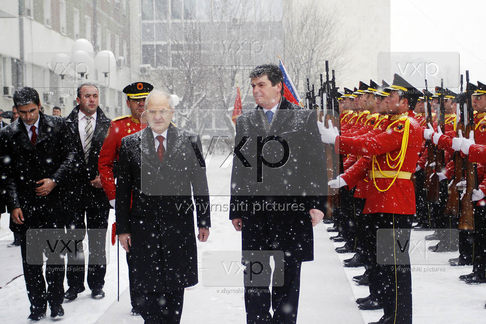 Albanian President Bamir Topi (R), is joined by his counterpart Kosovo President Fatmir Sejdiu (L), inspect members of the ceremonial guard of the Kosovo Protection Corps (KPC) in capital Pristina, on Thursday, Jan. 8, 2009.  (Photo/ Vudi Xhymshiti)