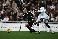 Photo: Rich Eaton.<br /> <br /> Swansea City v Bristol City. Coca Cola League 1. 26/11/2006. Steve Brroker (left) leads the Bristol attack away from Dennis Lawrence #22 of Swansea