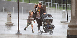 Rain pounds those brave enough to weather the drenching as they make their way around the Museum Campus near the Field Museum on Wednesday, July 12, 2017 in Chicago, Ill, USA. (Antonio Perez/Chicago Tribune/TNS)
