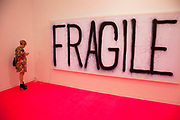 Fragile artwork by Rirkrit Tiravanija. Visitors and exhibitors at the many galleries exhibiting at the Frieze Art Fair 2012. This art fair is for work at the high end of international contemporary art with many well known artists on show from many of the world's most reknowned dealers.