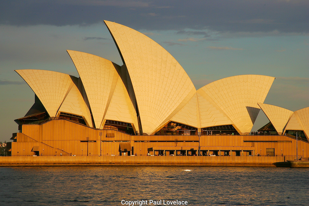 Sydney Opera House in late afternoon sun.