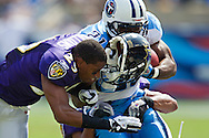 NASHVILLE, TN - SEPTEMBER 18:   Cary  Williams #29 of the Baltimore Ravens loses his helmet while making a hit on Javon Ringer #21 of the Tennessee Titans at the LP Field on September 18, 2011 in Nashville, Tennessee.  (Photo by Wesley Hitt/Getty Images) *** Local Caption *** Cary Williams; Javon Ringer Sports photography by Wesley Hitt photography with images from the NFL, NCAA and Arkansas Razorbacks.  Hitt photography in based in Fayetteville, Arkansas where he shoots Commercial Photography, Editorial Photography, Advertising Photography, Stock Photography and People Photography