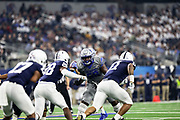 Penn State Nittany Lions quarterback (14) throws a pass under pressure from Memphis Tigers (9) during the game of the NCAA Cotton Bowl Classic football game, Saturday, Dec. 28, 2019, in Arlington, Texas. Penn State defeated Memphis 53-39. (Mario Terrana/Image of Sport)