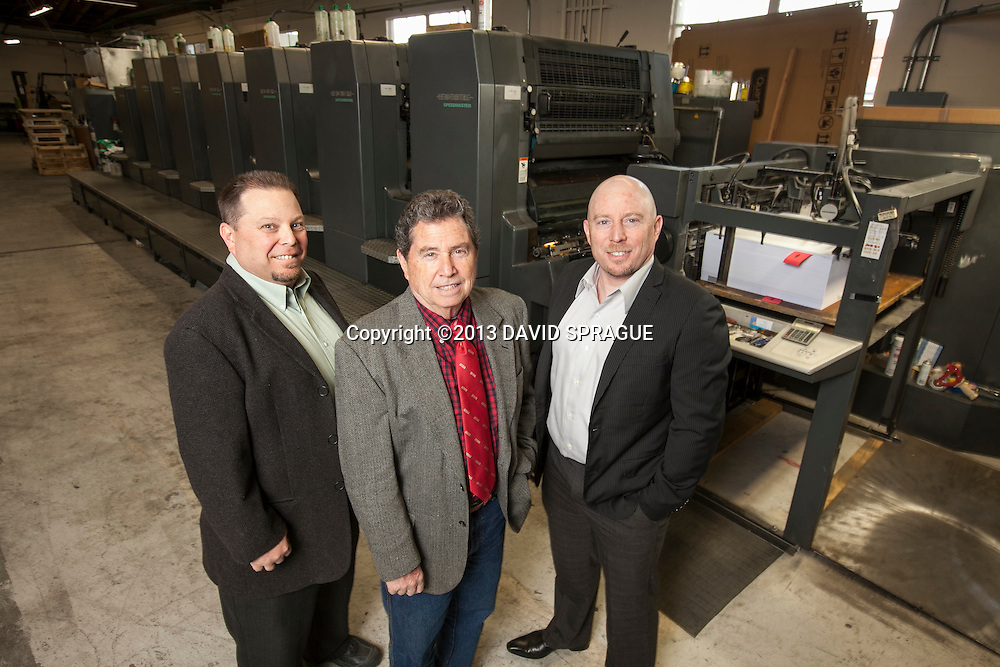 From left to right Fred, Jay and Phil Goldner, owners of The Harman Press, pose in front of their main press at the shop in North Hollywood, CA. Shot Feb. 19th,  2013 Photo by David Sprague ©2013