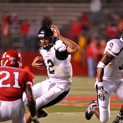 Sep 19, 2009; Piscataway, NJ, USA; Florida International quarterback Paul McCall (12) scrambles for a first down during the second half of Rutgers' 23-15 victory over Florida International at Rutgers Stadium.