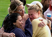 Students are comforted as they wait to be reunited with their parents following a shooting at Saugus High School that injured several people, Thursday, Nov. 14, 2019, in Santa Clarita, Calif. Nathaniel Berhow, a 16-year-old student, shot five classmates and then himself in the quad area of the school on his birthday in a 16-second rampage on the morning of Nov, 14, 2019. Two students, Gracie Muehlberger, 15, and Dominic Blackwell, 14, were killed. Berhow died of the self-inflicted gunshot on Nov. 15, 2019.