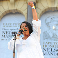 International artist VICKY SAMPSON, sings to the crowd of mourners. The City of Cape Town hosted an interfaith service on the Grand Parade as the day was declared a national day of prayer and reflection on the life of Nelson Mandela. Visitors also placed flowers and condolence messages on the barricade erected to accommodate it. Various religious leaders said prayers for the late South African President