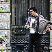 Street musician busking with an accordian in the Beyoglu district of Istanbul, Turkey.