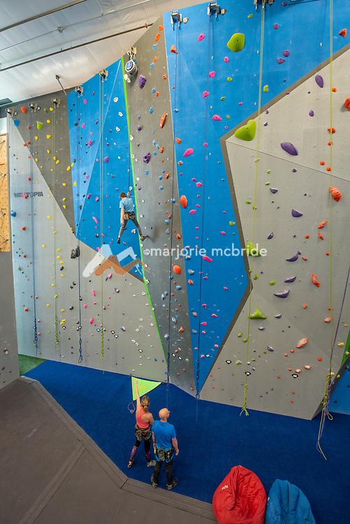 Family climbing at Gemstone an indoor climbing facility in Twin Falls, Idaho. MR