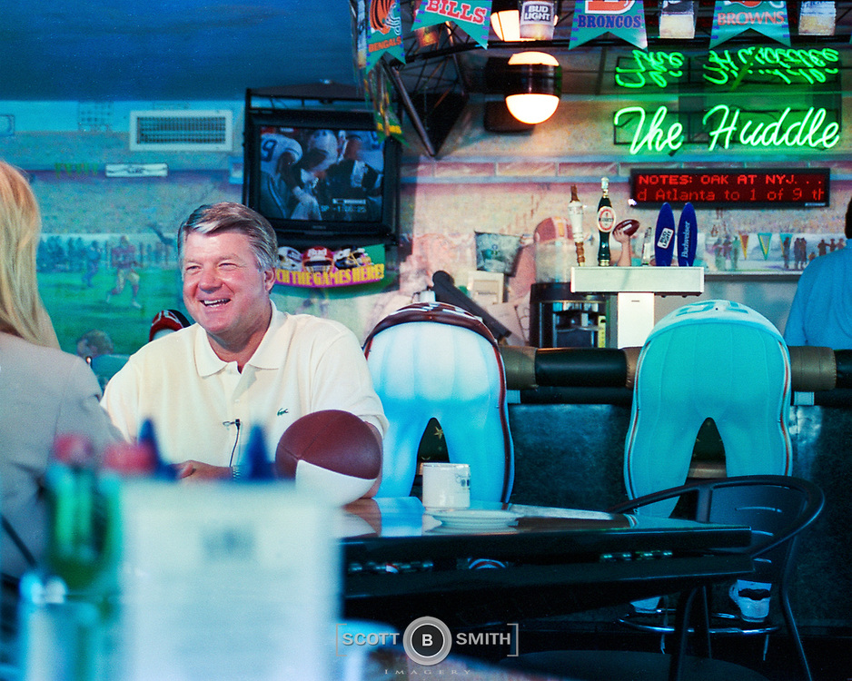 NFL Coach Jimmy Johnson during media interviews in his newly opened Three Rings Bar and Grill in the Eden Roc Resort, Miami Beach, January 1995.