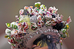 06 July 2013:  A bridesmaid displays a corsage made of Charms Blow Pops