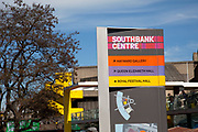 Sign for the Southbank Centre on a spring afternoon, London. South Bank is an area of London, England located immediately adjacent to the south bank of the River Thames. It forms a long and narrow section of riverside development that is within the London Borough of Lambeth and partly in the London Borough of Southwark. It developed much more slowly than the north bank of the river due to adverse conditions, and throughout its history has twice functioned as an entertainment district, separated by a hundred years of use as a location for industry. The South Bank is a significant arts and entertainment district.