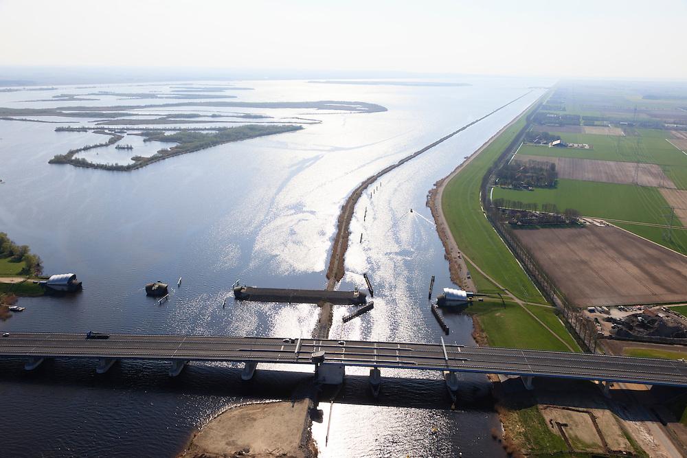 Nederland, Flevoland-Overijssel, Ramspol, 01-05-2013; Balgstuw met srekdam, rechts de vaargeul het Ramsdiep, links van de strekdam het Ketelmeer.<br /> Ramspol, inflatable dike, between Ketelmeer and Black Water. The Balgstuw (bellow barrier) is a storm barrier and consists of an inflatable dam or dyke, composed of three bellows. Usually, each bellow rests on the bottom of the water, but now the bellows are inflated  because of maintenance.<br /> luchtfoto (toeslag op standard tarieven)<br /> aerial photo (additional fee required)<br /> copyright foto/photo Siebe Swart