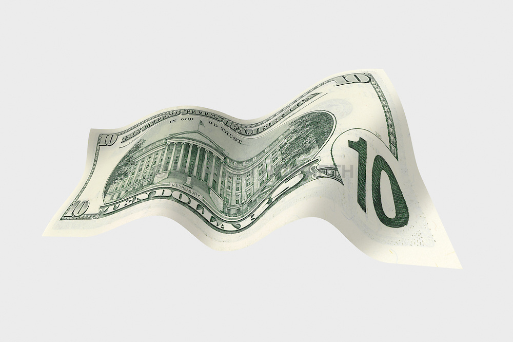 10 flat back 001 United States ten dollar bill floating on air with a white background