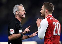 Arsenal's Shkodran Mustafi appeals to match referee Martin Atkinson during the Carabao Cup Semi Final, First Leg match at Stamford Bridge, London.