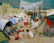 A group of families from Honduras all live next to one another at the asylum seekers' tent camp in Matamoros, Tamaulipas Mexico on Sunday, February 16, 2020.