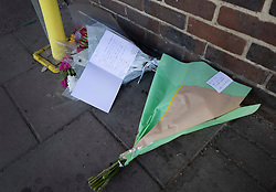 © Licensed to London News Pictures. 23/04/2021. Walton-on-Thames, UK. Flowers and cards have been placed outside a Marks and Spencer store in Walton-on-Thames after a man was killed in an altercation. Police were called to Church Street around 2.15pm on 22/04/2021 following reports that an altercation had taken place between a group of men. One of the men then got into his car, a white 1 series BMW, and is reported to have driven at two of the other men in the group.  One man was killed and another injured. The driver of the car has been arrested on suspicion of murder and attempted murder. Photo credit: Peter Macdiarmid/LNP