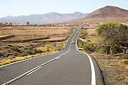 Tarmac road crossing countryside, Tefia, Fuerteventura, Canary Islands, Spain