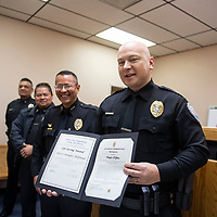 Officer Douglas Hoffman is presented with a life saving award and a certificate of commendation at the Gallup Police Department, Wednesday morning for his actions Dec. 8 when he responded to a call of an eight month old girl shot at the Zia Motel.