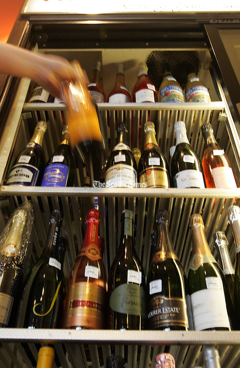 Champagne for sale at a local wine shop.<br /> Greg Gilbert / The Seattle Times