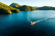 Aerial photograph of a commercial fishing boat steaming through the Inner Passage, Tongass National Forest, Southeast Alaska