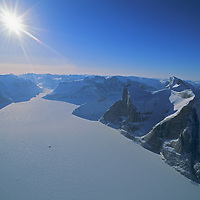 Polar Sun Spire and Broad Peak divide the Walker Arm (foreground) from Sam Ford Fjord, partly hidden behind the foreground peaks.
