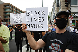 """WASHINGTON, USA - MAY 29: People hold banners reading """"Justice for George Floyd - Black Lives Matter"""", as crowds gather to protest after the death of George Floyd in Washington D.C. United States on May 29, 2020. Floyd, 46, a black man, was arrested Monday after reportedly attempting to use a counterfeit  bill at a local store. Video footage on Facebook showed him handcuffed and cooperating. But police claimed he resisted arrest. A white officer kneeled on his neck, despite Floyd's repeated pleas of """"I can't breathe."""" Former police officer Derek Chauvin was charged with third-degree murder and manslaughter, according to Hennepin County Prosecutor Michael Freeman. Minneapolis, Minnesota Mayor Jacob Frey said Friday he imposed a mandatory curfew because of ongoing protests regarding the death of George Floyd. Yasin Ozturk / Anadolu Agency/ABACAPRESS.COM  Minneapolis Etats Unis Etats-Unis United States of America USA Etats Unis USA United States of America United States US  