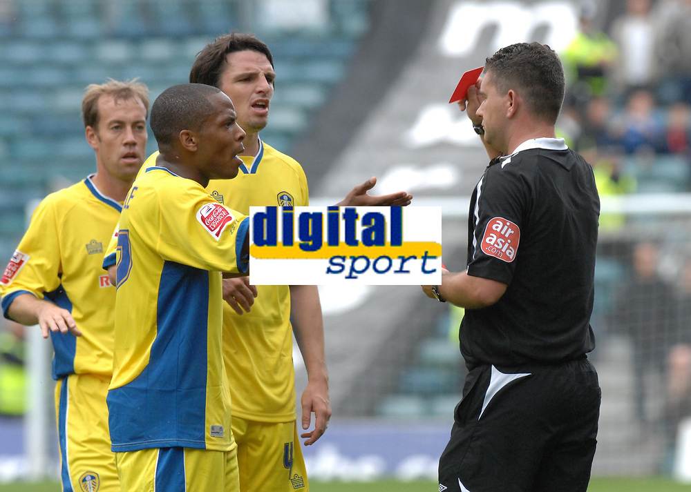 Photo: Ashley Pickering.<br /> Gillingham v Leeds United. Coca Cola League 1. 29/09/2007.<br /> The Leeds players protest as Ref Danny McDermid send Tresor Kandol off in the first half