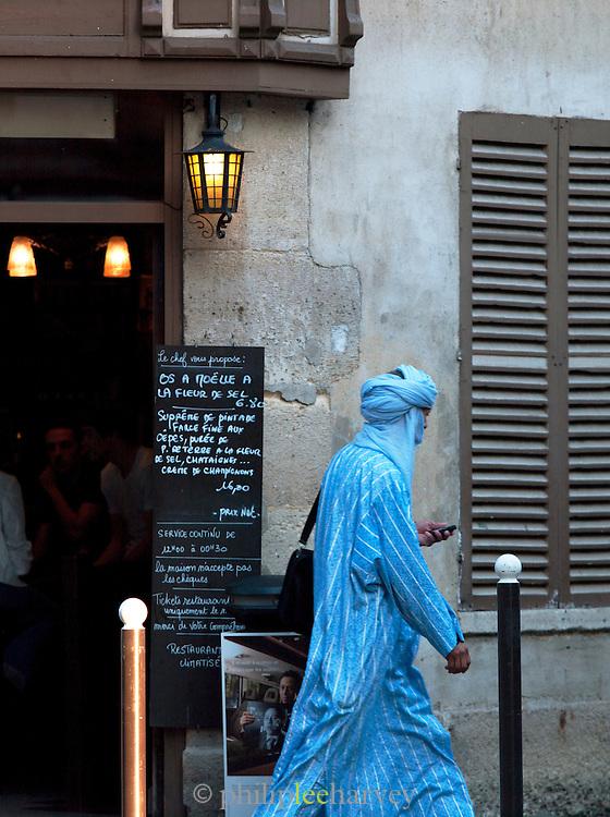 Islamic man walking in Belleville, Paris, France