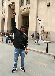 April 27, 2019 - New York City, New York, U.S. - Artwork by PAULO NAZARETH DRY CUT [from BLACKS IN THE POOL , which depicts sprinter Tommie Smith iconic 'Black Power' salute at the 1968 Olympics, on display at the Frieze Sculpture exhibit held at Rockefeller Center. (Credit Image: © Nancy Kaszerman/ZUMA Wire)