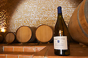 Cuvee Sainte Agnes. Domaine Ermitage du Pic St Loup, Chateau Ste Agnes. Pic St Loup. Languedoc. Barrel cellar. France. Europe. Bottle.