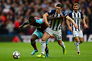 Michail Antonio of West Ham United battles with Gareth Barry of West Bromwich Albion. Premier league match, West Bromwich Albion v West Ham United at the Hawthorns stadium in West Bromwich, Midlands on Saturday 16th September 2017. pic by Bradley Collyer, Andrew Orchard sports photography.